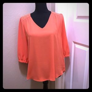 New w/out tags, peach colored blouse, back details